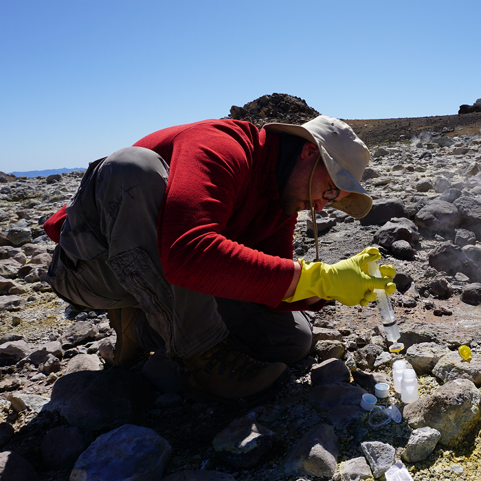 Water sampling on the Tolhuaca volcano in Chile during a research trip of Valentin Goldberg